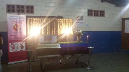 The casket of transgender activist Tania Vasquez, adorned with a rainbow flag. Vasquez's murder was one of five early 2013 killings that led to the Inter American Commission hearing in October, 2013. Photo taken in May 2013. Credit: Danielle Marie Mackey