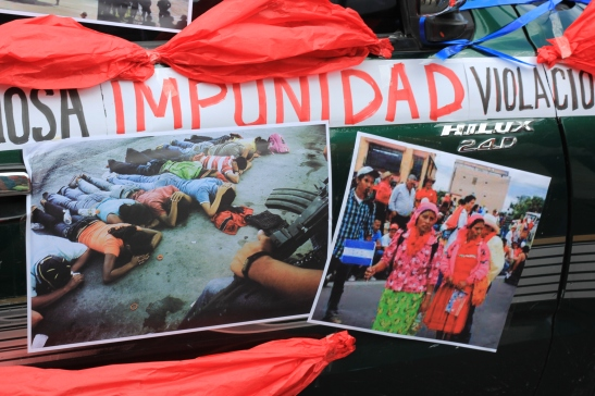 At the fifth anniversary of the coup in Honduras, protesters display photos and banners decrying impunity for human rights violations in the country. June 2014. Photo credit: Danielle Marie Mackey