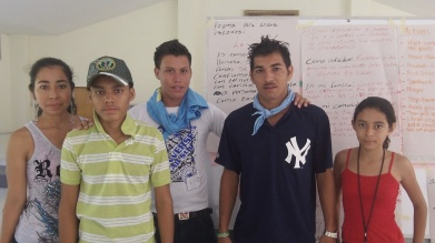Young people from a marginalized urban neighborhood in El Salvador gather at a youth retreat in 2012, organized by the Cristosal Foundation. Behind them is their proposal for ways to use their talents to improve their community.